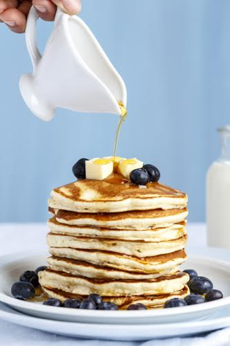 Fluffy American Pancakes served with Blueberries and Maple Syrup