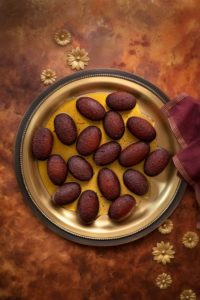 Overhead shot of Milk Powder Gulab Jamun served on traditional brass plate