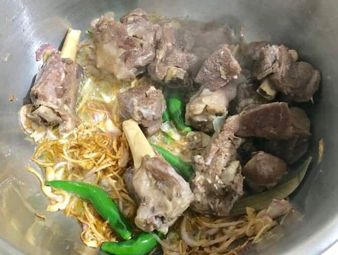 Boiled mutton pieces added in pan