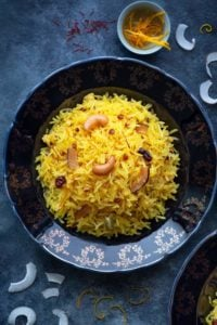 A close-up shot of Zarda pulao (sweet rice) served on a blue plate