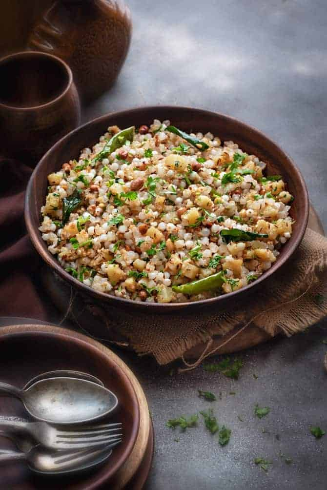 Spicy Sabudana Khichdi served in a large wooden bowl.