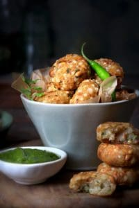 Crispy Sabudana Vada served in a bowl with green chutney on the side.