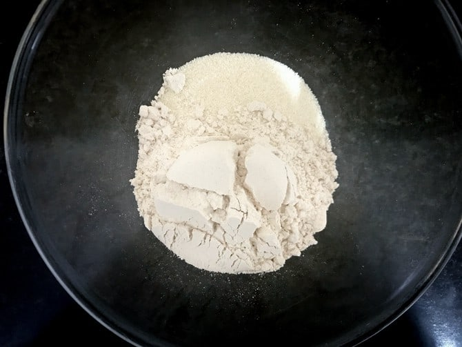 Whole wheat flour (atta) and semolina (Suji) in a large bowl