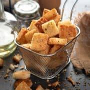 Crisp Garlic Croutons served in a metal basket