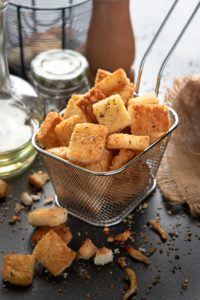 Crisp Garlic Croutons served in a metal basket