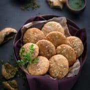 Matar Kachori in large wooden bowl with green chutney on the side