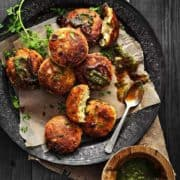 Delicious Paneer Kabab served on traditional plate with spicy and sweet chutneys on the side