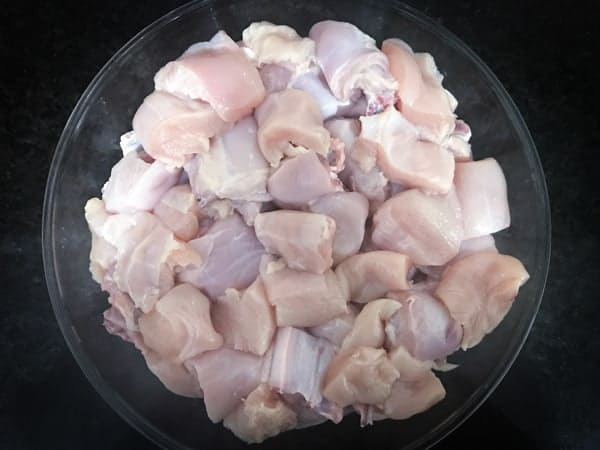 Cleaned Chicken pieces in large bowl