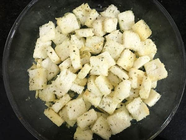 Bread cubes mixed well with seasonings