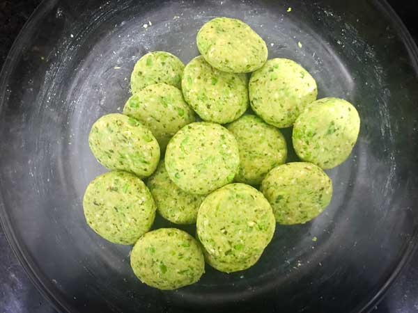 Shaped paneer matar patties in a bowl ready to fry