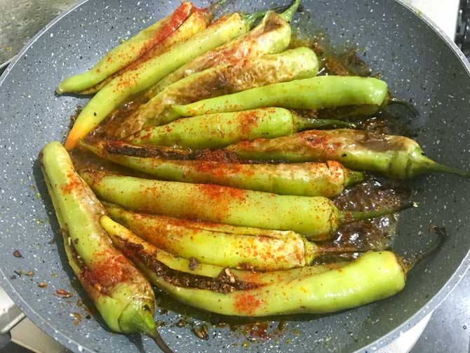 Red Chilli powder and lemon juice added in pan