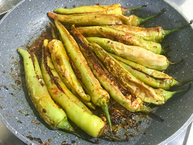 Achari bharwa mirchi fry ready in pan