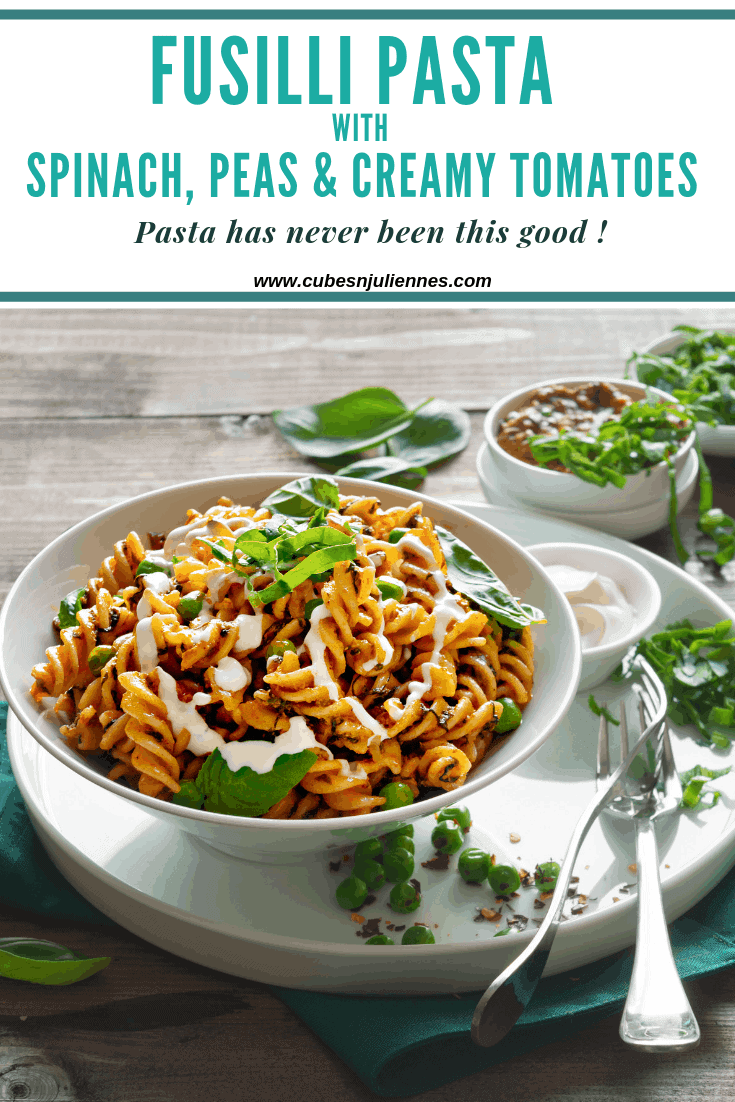 Fusilli pasta with Spinach and Tomatoesis a delicious Italian recipe of spiral pasta tossed with spinach, peas in fresh tomato sauce studded with cream, basil and garlic for most amazing flavour to give you an enticing treat. #dinner #simple #healthy #kids