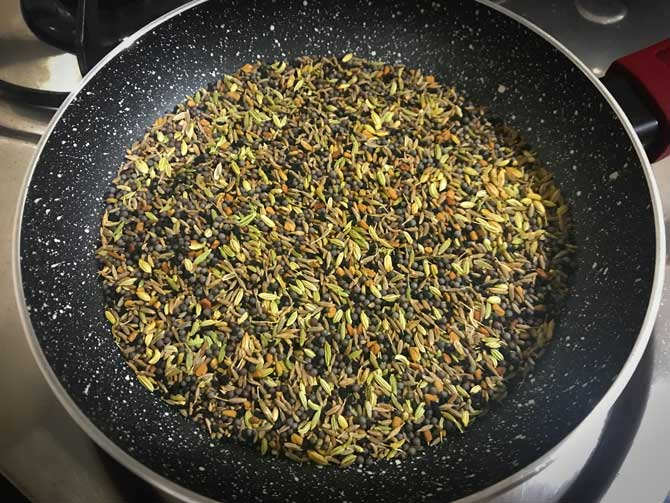 All the seeds roasting in pan for the making of achari masala recipe