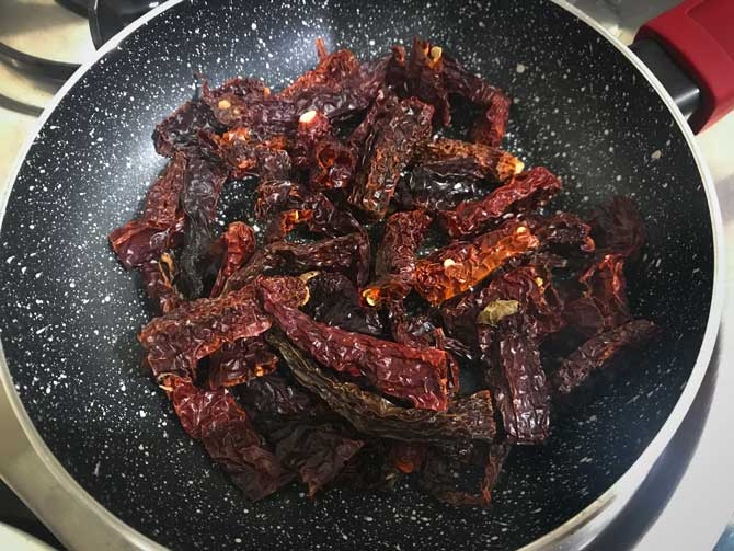 Dried red chilies roasting pan for the making of Achari masala powder