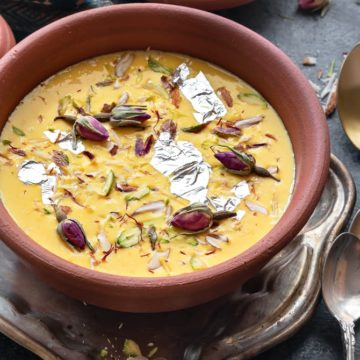 Close up shot of kesar Rabdi or sweetened condensed milk served in earthen pot.