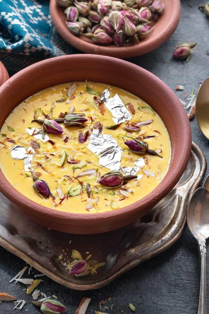 Close up shot of kesar Rabdi or sweetened condensed milk served in earthen pot.