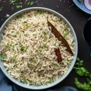 Close up shot of Jeera Rice served in bowl