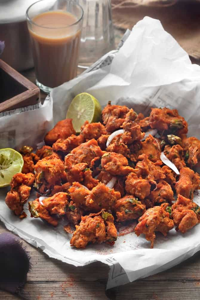 Close up shot of chicken pakora on parchment lined paper.