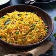 Semiya upma or vegetable vermicelli upma in wooden bowl, spoons and chutney at the back.