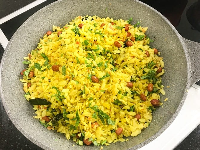 Cooked poha in pan.