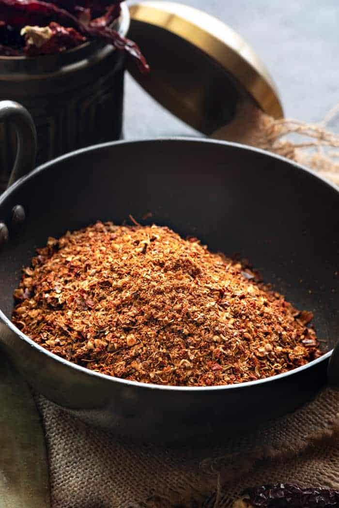 Close up shot of kadai masala powder in kadai or Indian wok.