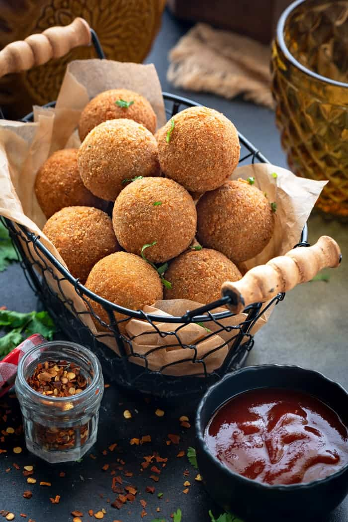 Crisp corn and cheese balls served in basket.