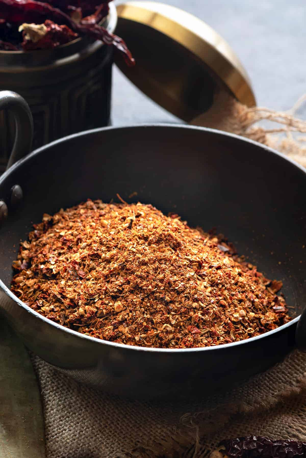 Close up shot of kadai masala powder in Indian wok.