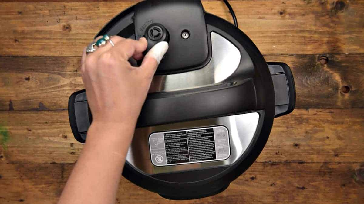 Manually quick releasing the Instant Pot.