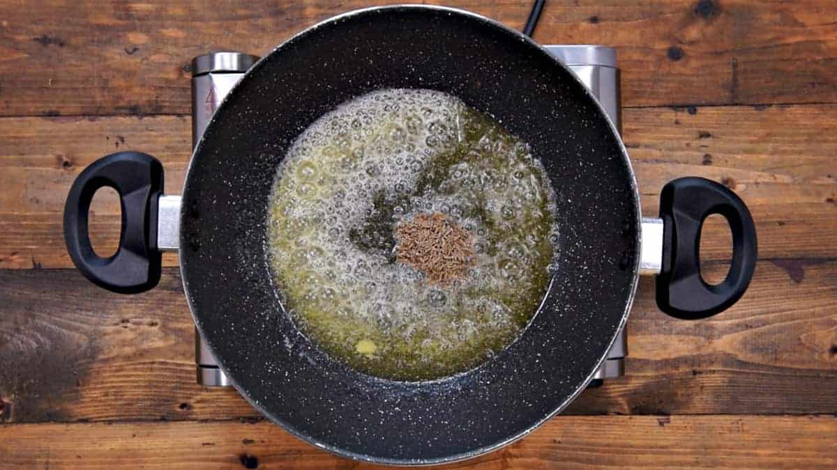 Cumin seeds added in pan.