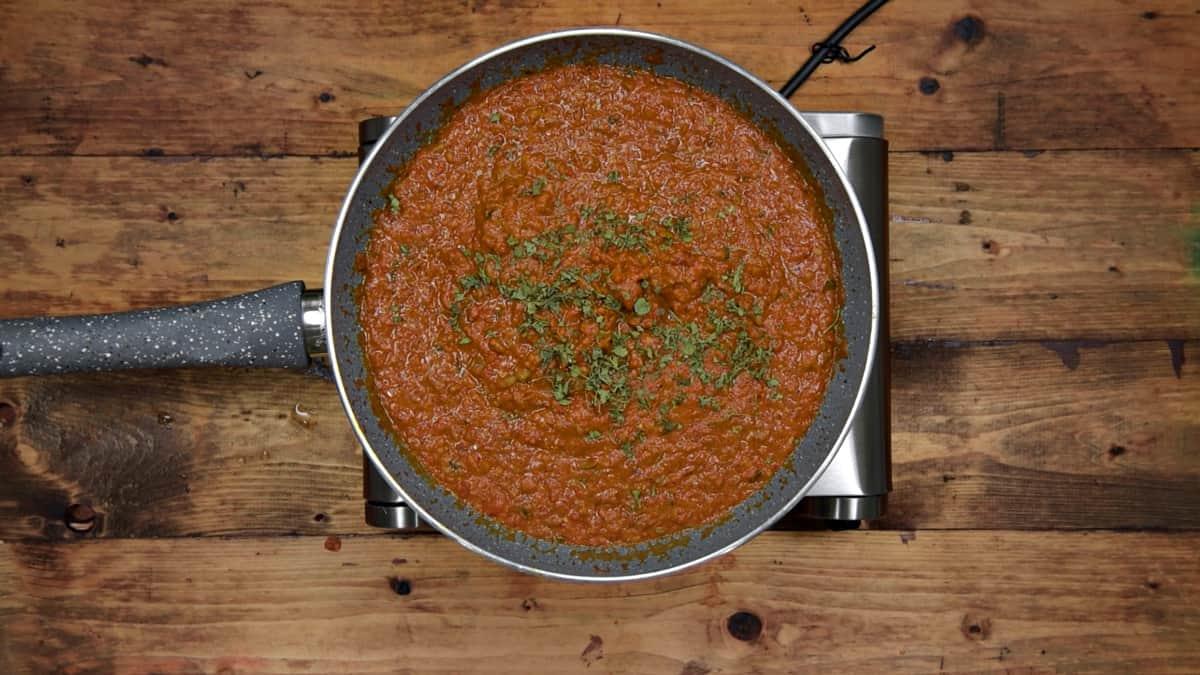 Cooked vegetable bhaji gravy in pan.