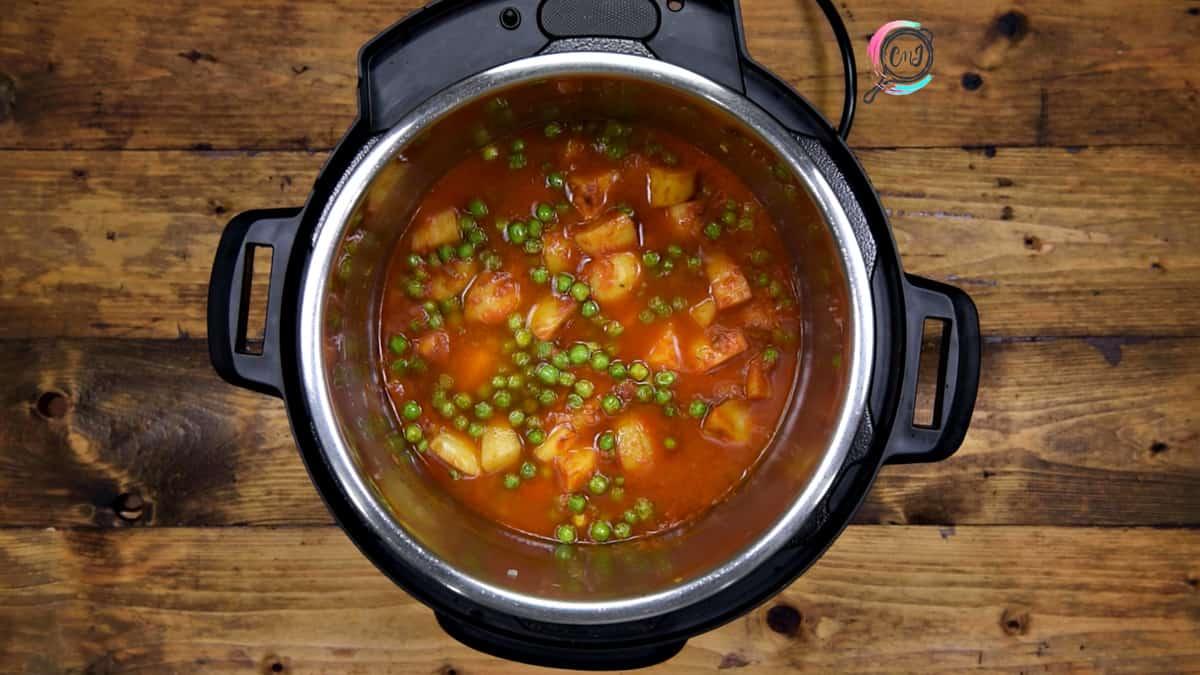 Salt, Garam Masala and water added into the steel pot.