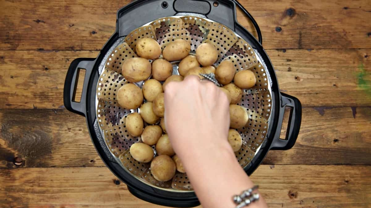 Taking out the boiled potatoes from the Instant Pot.