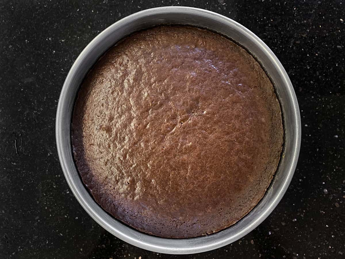Baked Eggless chocolate cake in tin.