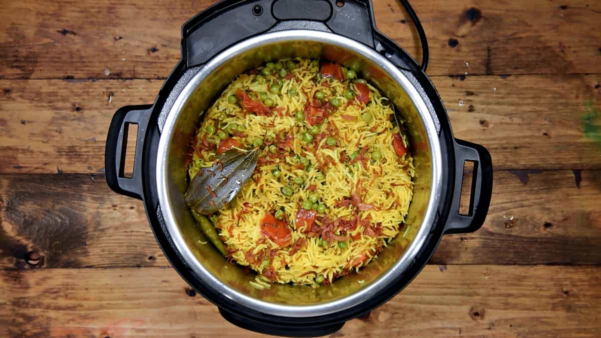 Cooked and garnished pulao in the Instant pot.