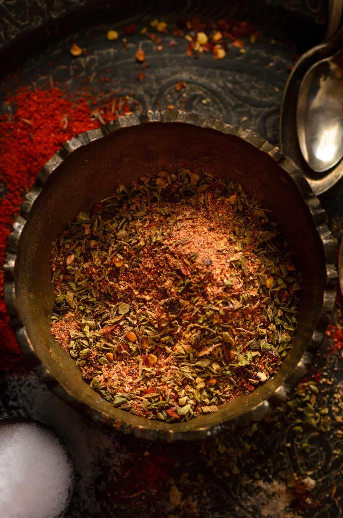 Overhead shot of Cajun seasoning spice mix in brass bowl.
