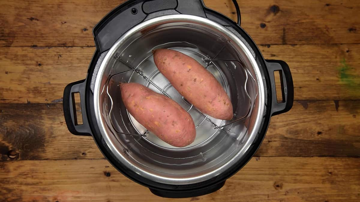 Placed two large sweet potatoes on the trivet.
