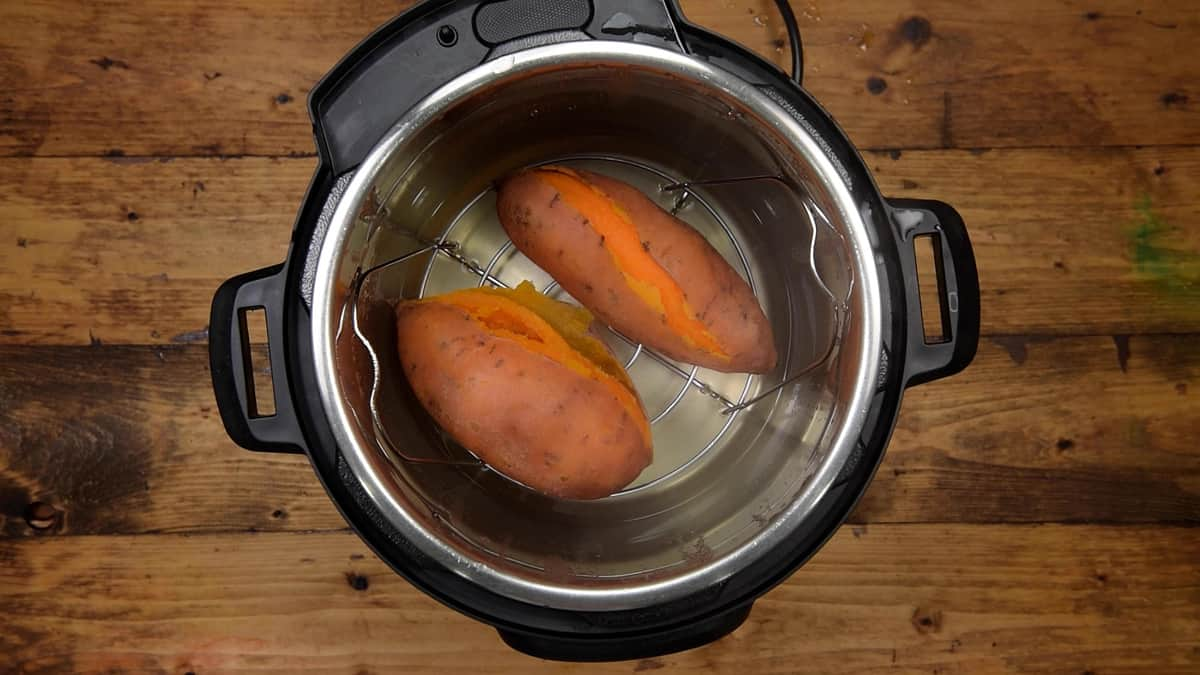 Steamed sweet potatoes on the trivet in the instant pot.