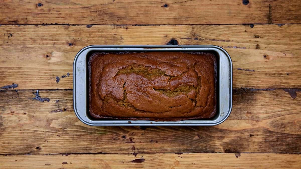 Baked Pumpkin bread in loaf pan straight out of the oven.