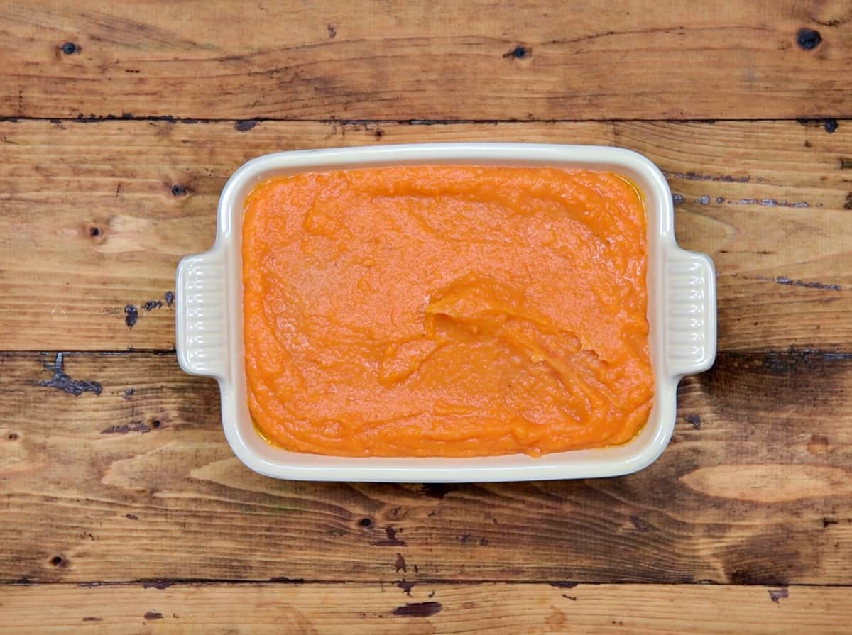 Whisked sweet potato mixture added to greased casserole dish.