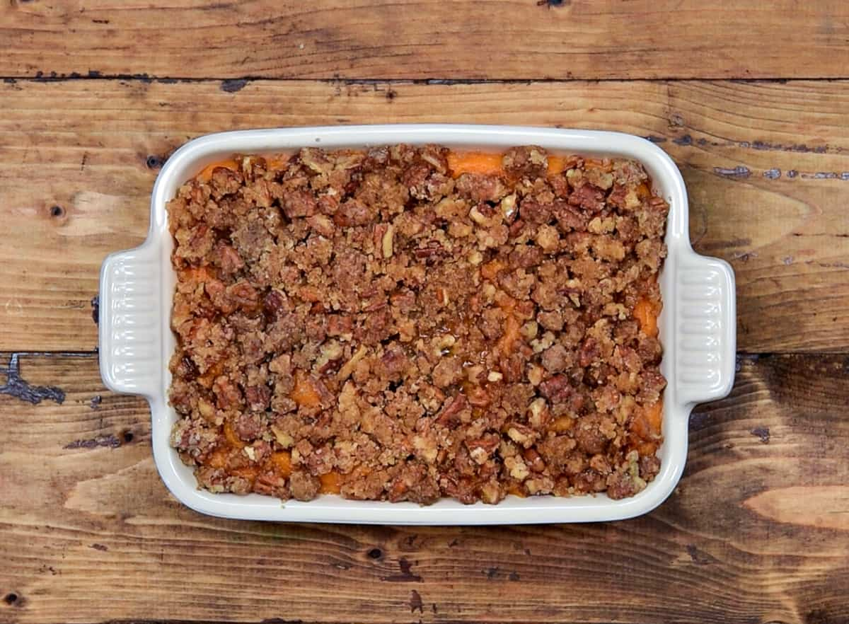 Pecan streusel topped on half baked sweet potato casserole.