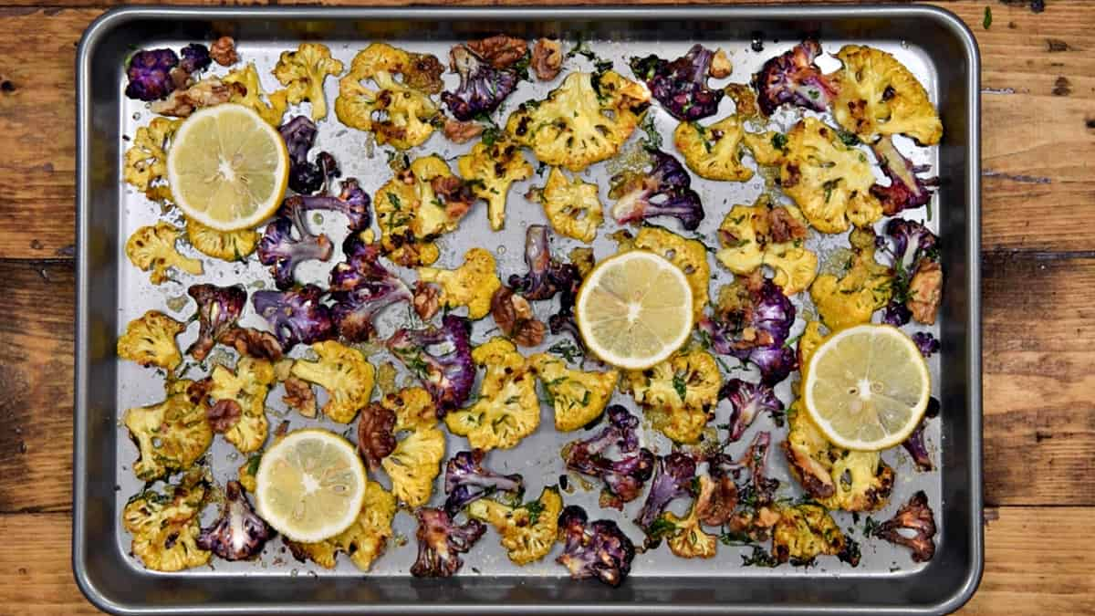 completed oven roasted cauliflower parmesan on a sheet pan