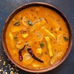 close up shot of vegetable sambar dal in wooden bowl.