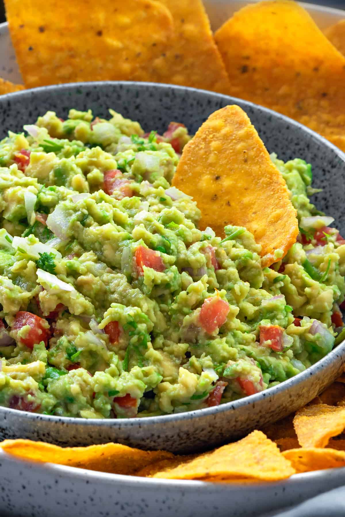 Close up shot of a bowl of chunky guacamole