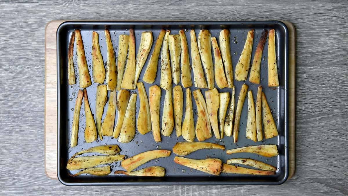 roasted parsnips on a sheet pan