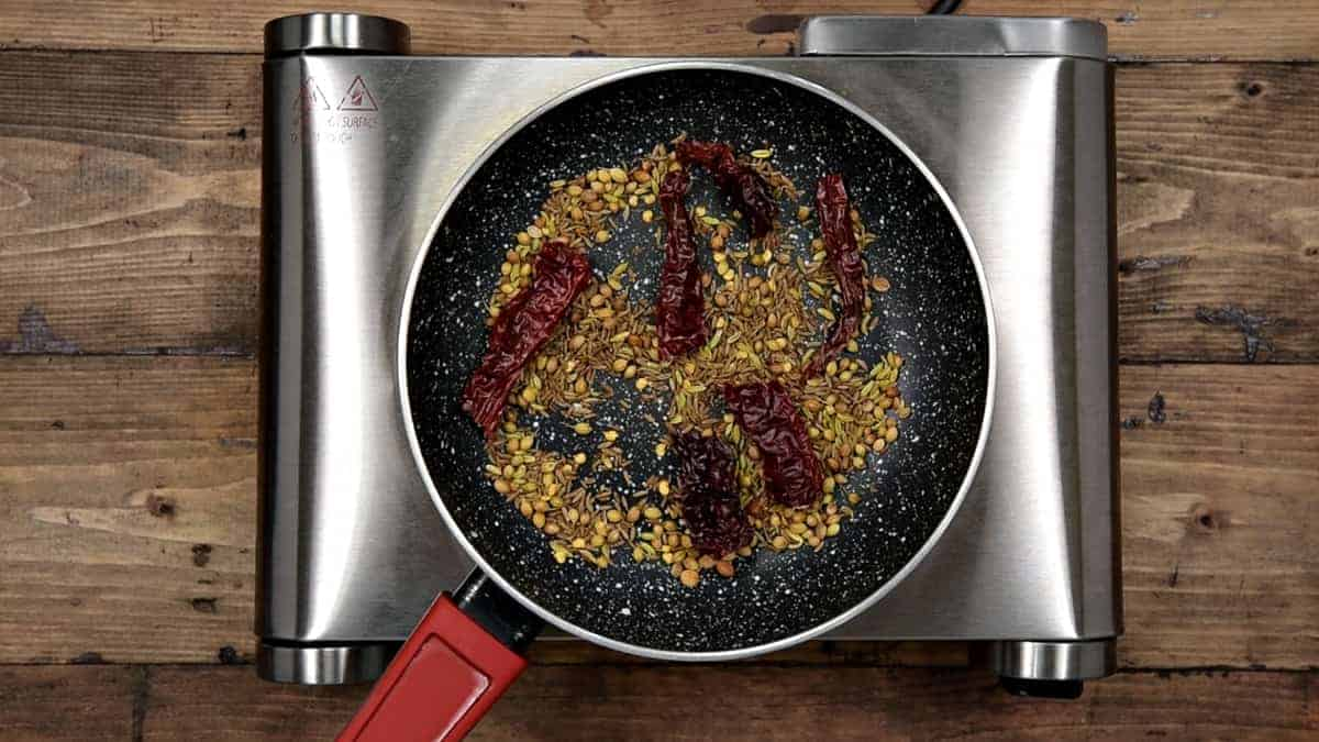 cumin seeds, fennel seeds, coriander seeds and dried red chilies  dry roasting in small pan