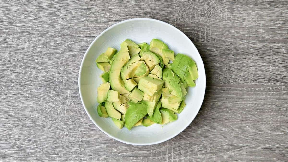 cubed avocado in a white bowl