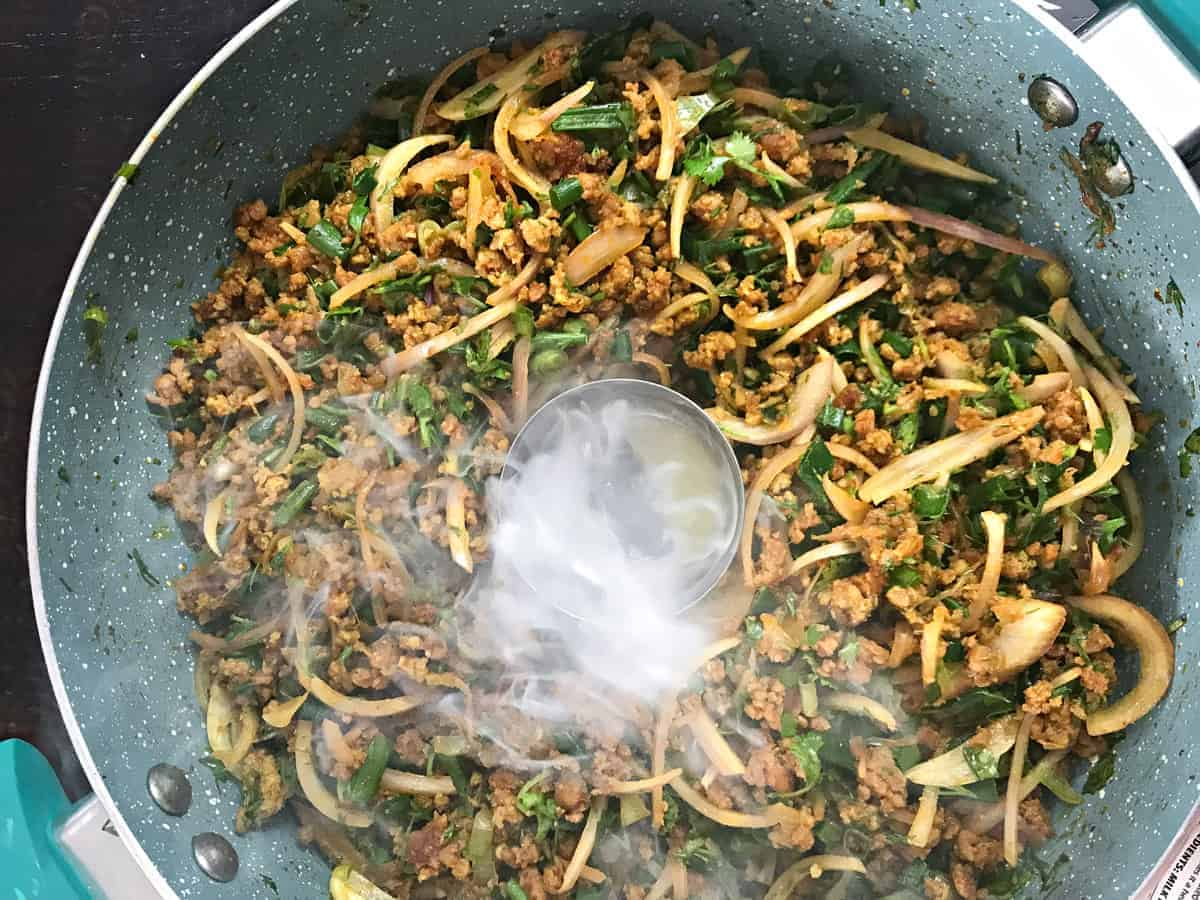 ghee added to charcoal in dish to smoke the keema meat filling