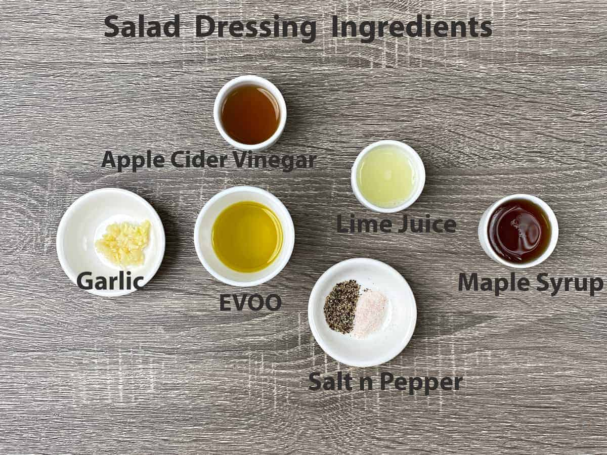 Strawberry spinach salad dressing ingredients - ACV, EVOO, lime juice, maple syrup, garlic, salt and pepper