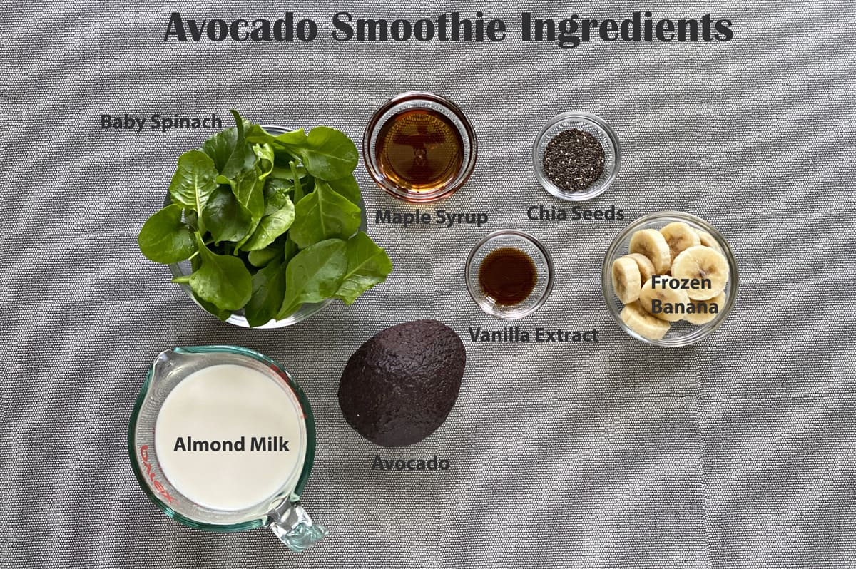 ingredients to make spinach avocado smoothie - spinach, maple syrup, chia seeds, frozen bananas, vanilla extract, avocado and almond milk